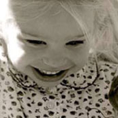 little girl looking down and smiling